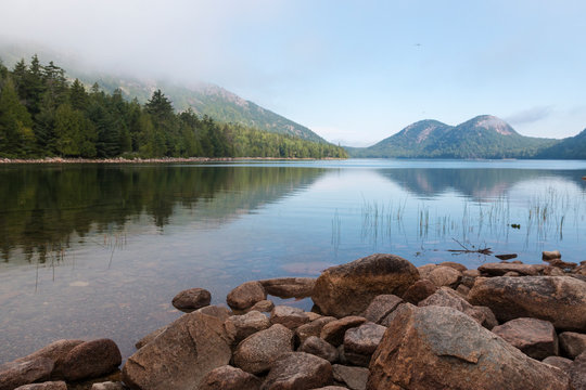 A landscape view of the Bubbles from Jordan Pond in Acadia National Park in Maine.