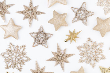 Christmas composition. Stars decorations, on white background. Christmas, winter, new year concept. Flat lay, top view, copy space.