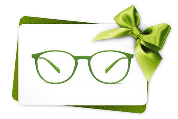 Fotomurales - eyeglasses gift card, green spectacles and green ribbon bow, isolated on white background
