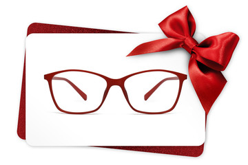 Fotomurales - eyeglasses gift card, red spectacles and red ribbon bow, isolated on white background