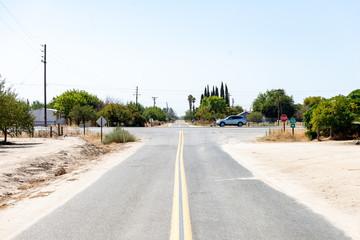 road crossing in almond farmland