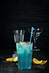 Alcoholic cocktail Blue Lagoon. Drinking On a wooden background. Top view.