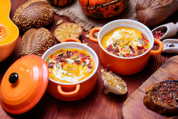 traditional pumpkin cream soup in a rustic style. healthy eating concept.