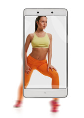 Young sporty woman doing squat fitness exercises. conceptual image with a smartphone, demonstration of device capabilities