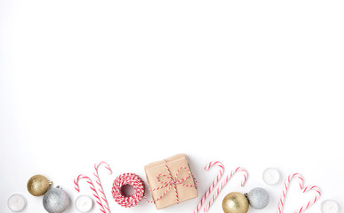 Frame from golden and silver balls, gift, candles, lollipops, Top view White Background Christmas New Year