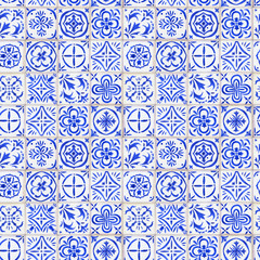 Seamless background with floral ornament - vintage ceramic tiles in azulejo design with blue elements on white background. Watercolor hand drawn painting illustration.