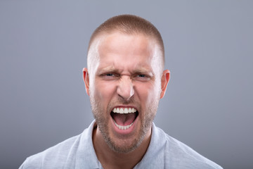 Portrait Of A Shouting Young Man