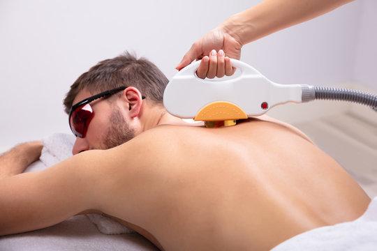Man Receiving Laser Epilation Treatment