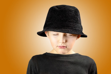 young boy with very calm, meditating and focused expression of his face and body gesture with free copy space for the text