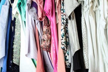 Woman blouse hanging in the closet