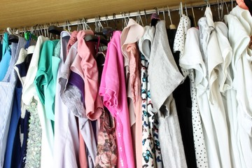 Group of blouses hung for a long time - with dust - in the closet