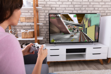 Woman Playing Video Game With Joystick