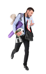 Businessman with lots of things running while talking on phone against white background. Combining life and work