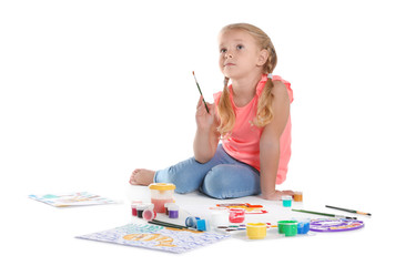 Cute child painting picture on white background