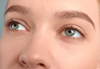 Young woman with beautiful natural eyelashes, closeup