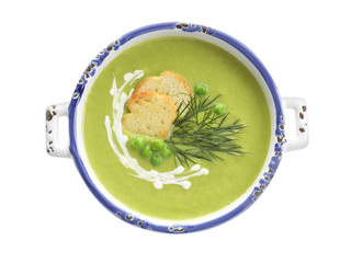 Fresh vegetable detox soup made of green peas with croutons on white background, top view