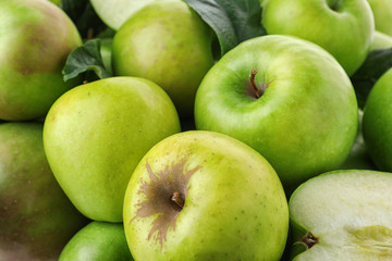 Many ripe juicy green apples as background