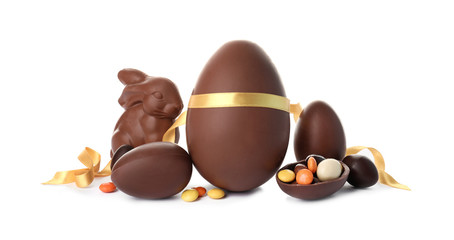 Composition with chocolate Easter eggs on white background