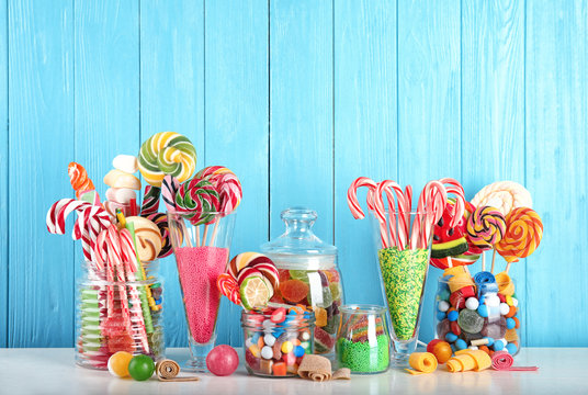 Composition with many different candies on table