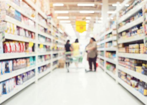 Supermarket or retail store interior or blur background. That is a self-service shop offering grocery and variety of food, beverages and household product on shelf or rack. For shopping background.