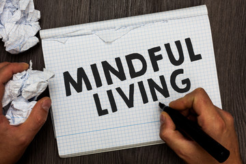 Writing note showing Mindful Living. Business photo showcasing Fully aware and engaged on something Conscious and Sensible Man holding marker notebook crumpled papers several tries made