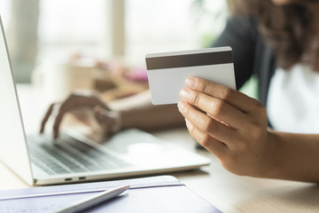 close up shots hands of person shopping on ecommerce and using credit card payment via online banking.