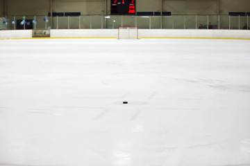 Hockey puck on Ice rink