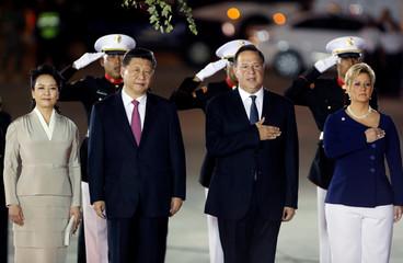 Panama president Juan Carlos Varela and firts lady Lorena Castillo receive China's President Xi Jinping and his wife Peng Liyuan at Tocumen International airport in Panama City