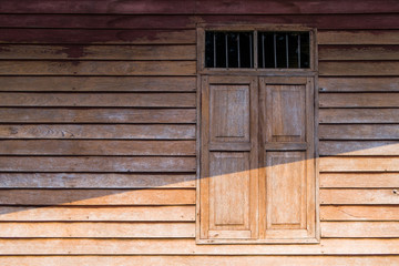 Walls and windows, stained wood and old brown stains in rural areas.