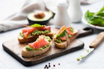 Salmon toast with avocado. Healthy snack or appetizer