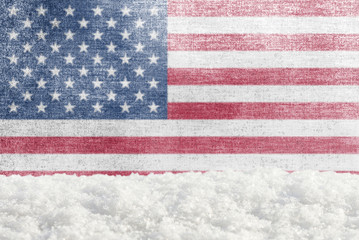 Winter grunge background with snowdrift and American flag in the backdrop