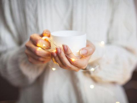 Coffee mug in female hands
