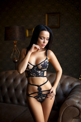 Perfect girl in a sexy dark lingerie