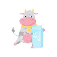 Lovely cow with paper box of milk, funny farm animal cartoon character standing and holding milk packaging vector Illustration on a white background
