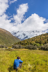 Nature landscape photography photographer shooting in New Zealand. Beautiful travel destination tourism hiker taking pictures on Routeburn track, famous tramping trail in south island.