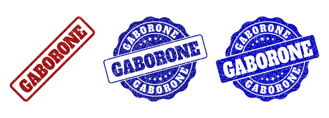 GABORONE grunge stamp seals in red and blue colors. Vector GABORONE marks with grunge surface. Graphic elements are rounded rectangles, rosettes, circles and text titles.