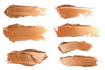 Set of shiny beige brush strokes of acrilic or oil paint isolated on white