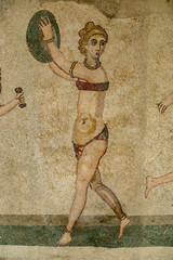 Ancient bikini girl of mosaic stones in Sicily