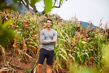 Good looking guy by field in countryside, portrait