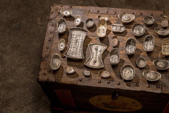 Gold ingot and silver treasure