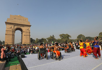 A group of differently-abled artists perform on a stage in front of India Gate at an event organised on the occassion of International Day of Disabled Persons, in New Delhi