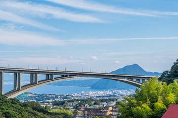 Bridge with Beppu city and blue sky background