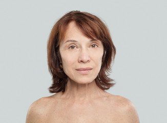 Mature woman on white. Face lifting, cosmetology, aesthetic medicine and plastic surgery concept