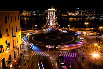 Budapest panorama at night with Chain Bridge over Danube and the St. Stephen Basilica's tower in the background