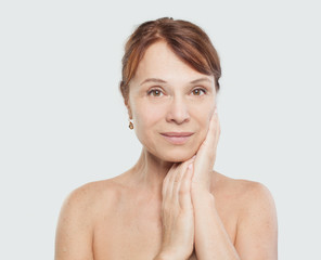 Beautiful female face on white background. Facial treatment, aesthetic medicine and plastic surgery