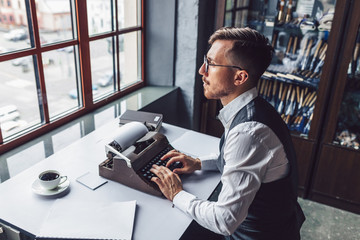 Working man with a retro typewriter