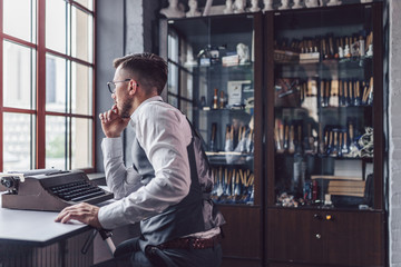 Thinking young man at the desk