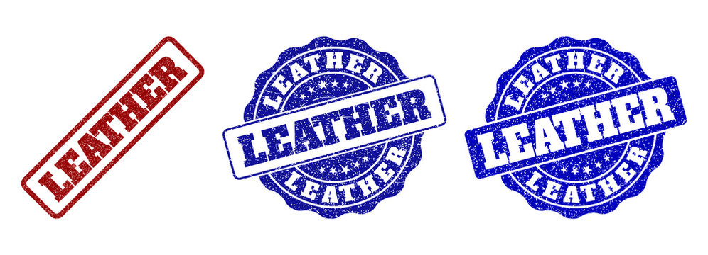 LEATHER grunge stamp seals in red and blue colors. Vector LEATHER watermarks with grunge surface. Graphic elements are rounded rectangles, rosettes, circles and text captions.
