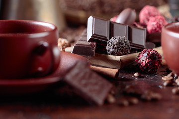 Various chocolates  and cup of black coffee.