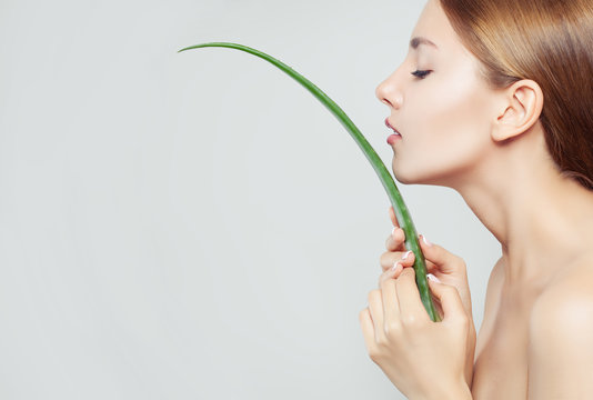 Healthy woman with clear skin and aloe leaf